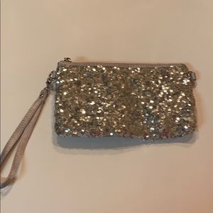 Charming Charlie's silver sequin wristlet